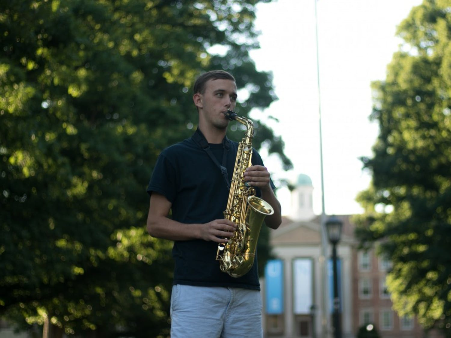 Bryce Lapping, senior political science and journalism major, plays the alto saxophone with the Marching Tar Heels.