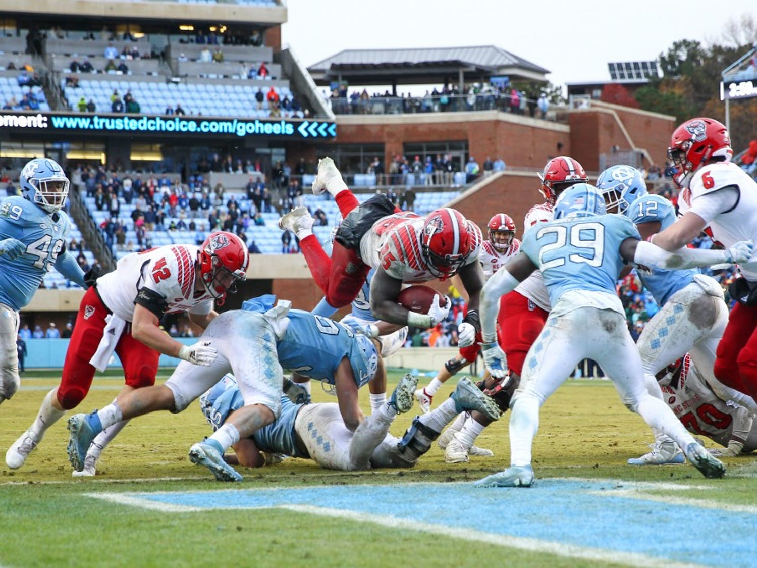 NC State's Reggie Gallaspy II (25) leaps for the game winning touchdown in overtime on Saturday, Nov. 24, 2018 in Kenan Memorial Stadium. NC State beat UNC 34-28 in overtime.