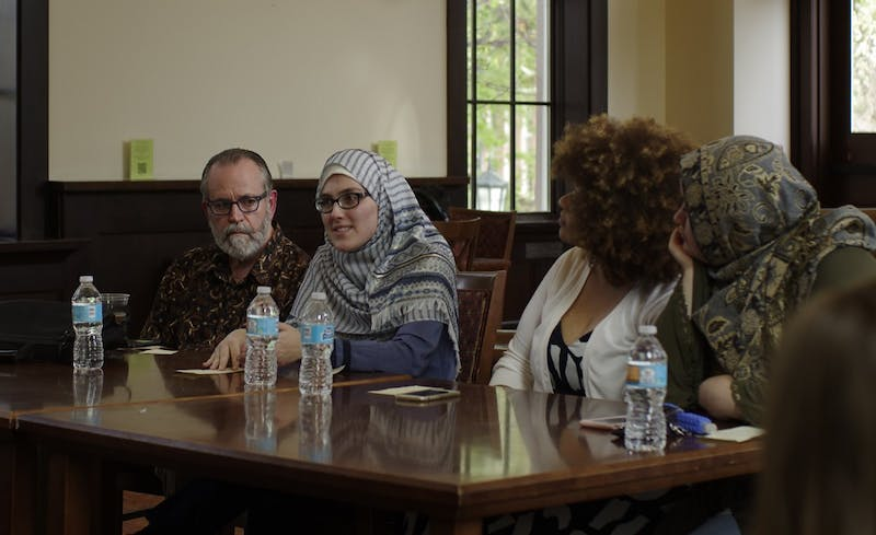 From Left, Professor Carl Ernst, Soumaya Lansari, Iyman Gaspard and Mariam Baaj speak at the Understanding Muslims and Islam Panel at the Campus Y on Monday.