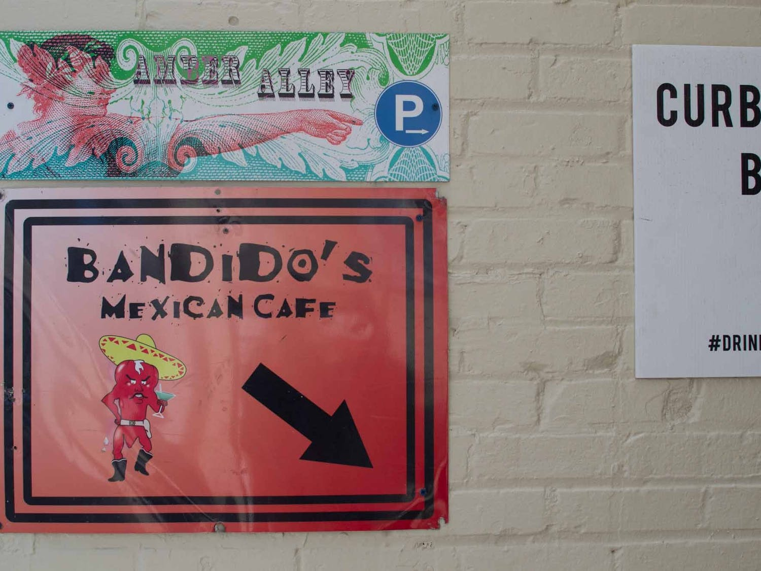 A sign on Franklin Street directs pedestrians down to Bandidos Mexican Cafe on Feb. 4, 2021. After struggling with financial stress created by the COVID-19 pandemic, Chapel Hill restaurant Bandido's started a GoFundMe campaign last month to supplement its lull in foot traffic.