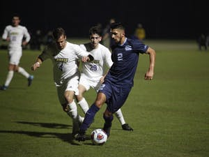 Junior midfielder Mauricio Pineda (2) fights for the ball against JMU midfielder Tim Estermann (4) and midfielder Fernando Casero (29) during the game Sunday, Nov. 18, 2018 at WakeMed Soccer Park. JMU defeated UNC 2-1 to continue to the third round of the NCAA Tournament.