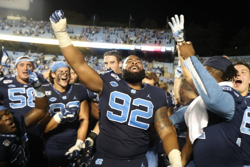 Senior defensive lineman Aaron Crawford (92) celebrates with his teammates after the win against Duke on Saturday, Oct. 26. 2019. UNC defeated Duke 20-17.