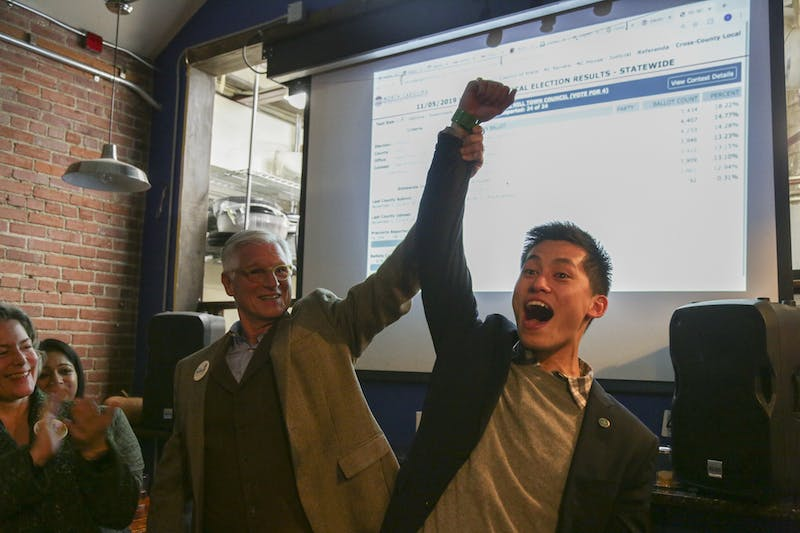 UNC student and Chapel Hill Town Council candidate Tai Huynh celebrates at a local election watch party on Tuesday, Nov. 5, 2019.