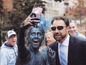 Alex Koszeghy, better knownas Glitter Girl, takes a selfie with North Carolinafootball head coach Larry Fedora.Photo courtesy of Alexa Blaze.