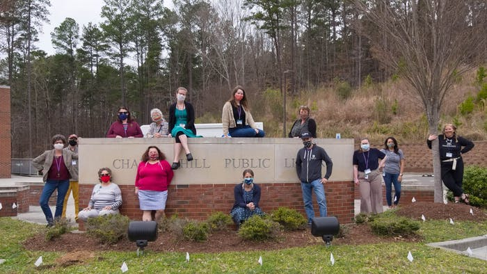The Chapel Hill Public Library staff pose for a group portrait on Wednesday, Mar. 24, 2021. The library was named as a finalist for 2021 IMLS National Medal for Museum and Library Service.