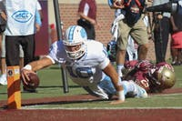 Former North Carolina quarterback Mitchell Trubisky (10) dives for a touchdown against Florida State in 2016.