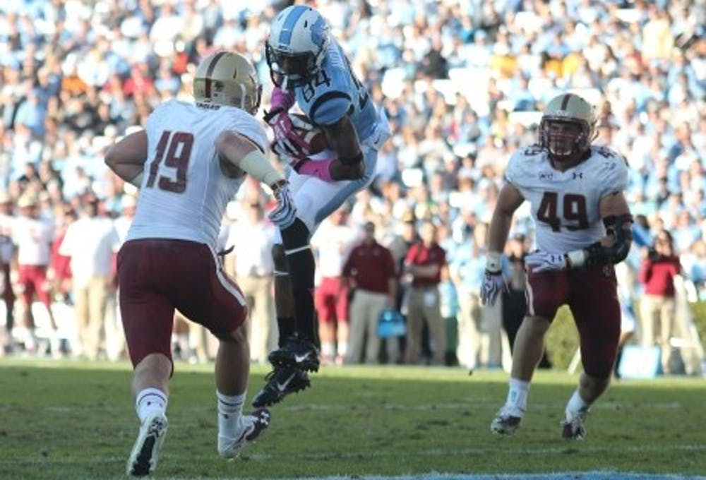 <p>UNC wide receiver Bug Howard (84) catches a pass for a touchdown in a game against Boston College. Howard finished the 2014 football season with 42 catches and 455 yards with 2 touchdowns.</p>