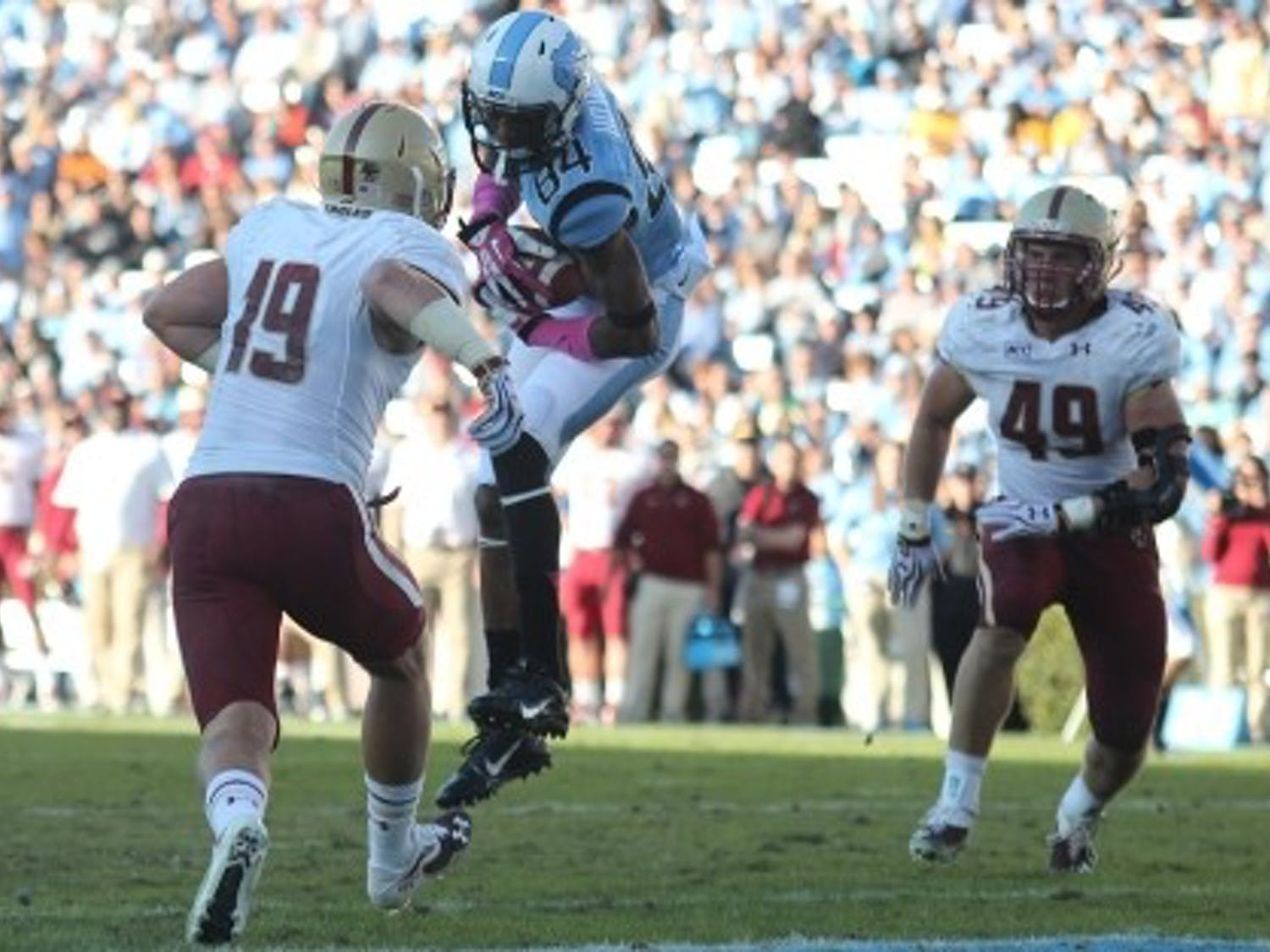 UNC wide receiver Bug Howard (84) catches a pass for a touchdown in a game against Boston College. Howard finished the 2014 football season with 42 catches and 455 yards with 2 touchdowns.