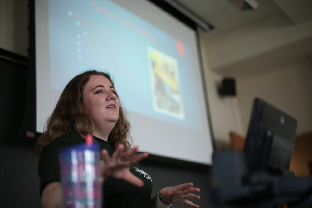 "Senior biology major Paige Springman walks her group of high school students through the history of zombie-themed movies during her ""A 'Fleshed' Out History of Zombies"" class during the Splash UNC event on Saturday, March 30, 2019."