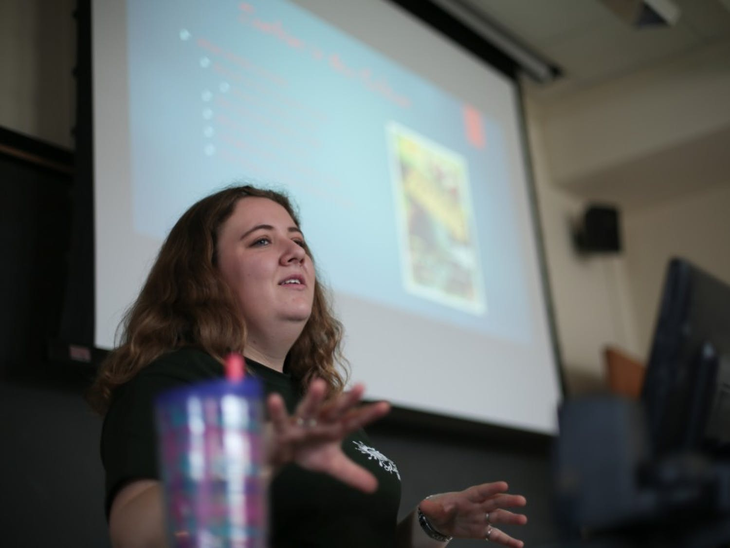 """Senior biology major Paige Springman walks her group of high school students through the history of zombie-themed movies during her """"A 'Fleshed' Out History of Zombies"""" class during the Splash UNC event on Saturday, March 30, 2019."""