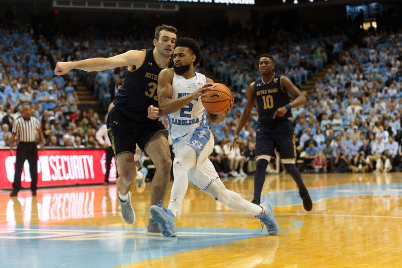Guard Joel Berry II (2) dribbles the ball past a Notre Dame defender during UNC's 83-66 win on Feb. 12 in the Smith Center.
