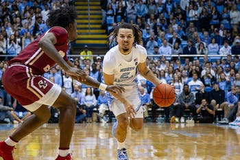 UNC first-year guard Cole Anthony (2) attempts to dribble past Boston College first-year forward CJ Felder during a game against Boston College in the Smith Center on Saturday, Feb. 1, 2020. UNC fell to Boston College by just one point in the last minutes of the game, making the final score 71-70.