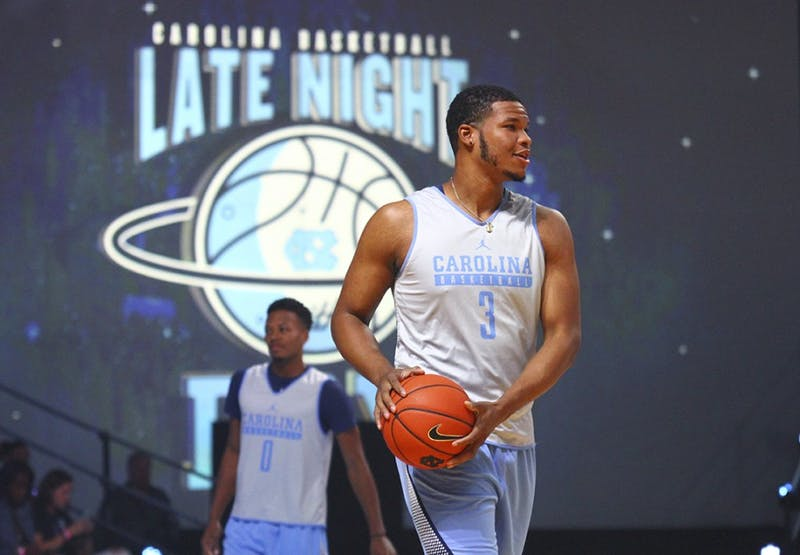 Kennedy Meeks (3) and Nate Britt (0) get ready for games at Late Night With Roy on Friday night.