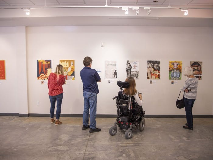 The 2014 and 2015 winners of the Banned Books art competition inspire awe in several visitors to the installation currently being hosted on 109 E. Franklin St. on Monday, September 16, 2019. The exhibit features different artists's expressions of famous banned books in a gallery put together by Chapel Hill Public Library in honor of Banned Books Week.