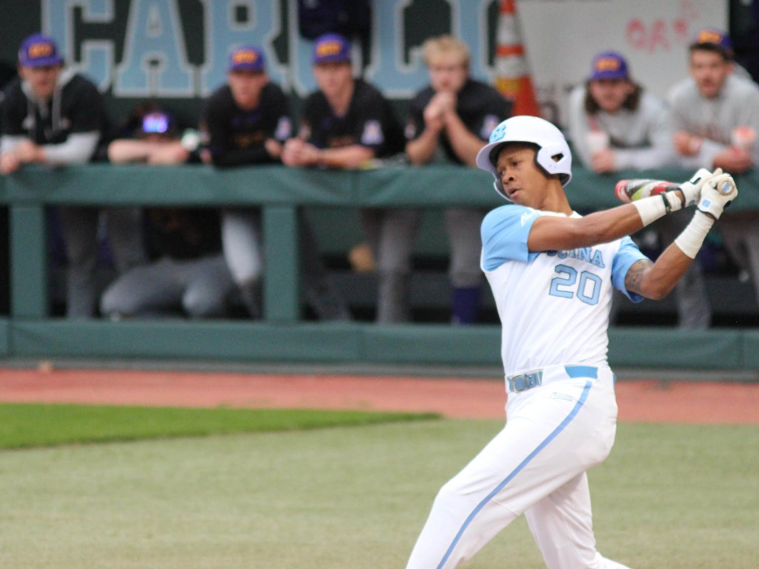 UNC sophomore outfielder Justice Thompson (20) offers at a pitch during the Tar Heels' game against East Carolina University at Boshamer Stadium on March 23, 2021. The Tar Heels defeated the Pirates 8-1.