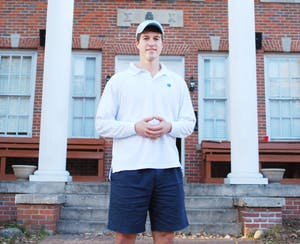 Current IFC President Brent Mason stands in front of his fraternity, Sigma Chi.