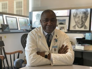 Director of global surgery at the Institute of Global Health and Infectious Diseases at the UNC School of Medicine Dr. Anthony Charles poses for a portrait on April 18, 2021. Dr. Charles is working to improve surgical quality in middle to low income N.C. counties.