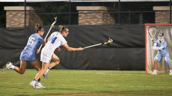 Duke attacker, Olivia Jenner (14), and UNC defender, Charlotte Sofield (15), fight for possession of the ball.   No.3 UNC defeated No.13 Duke 19-5 on Saturday, April 20, 2019 at Koskinen Stadium at Duke University. UNC will enter the upcoming ACC Tournament as a No.2 seed.
