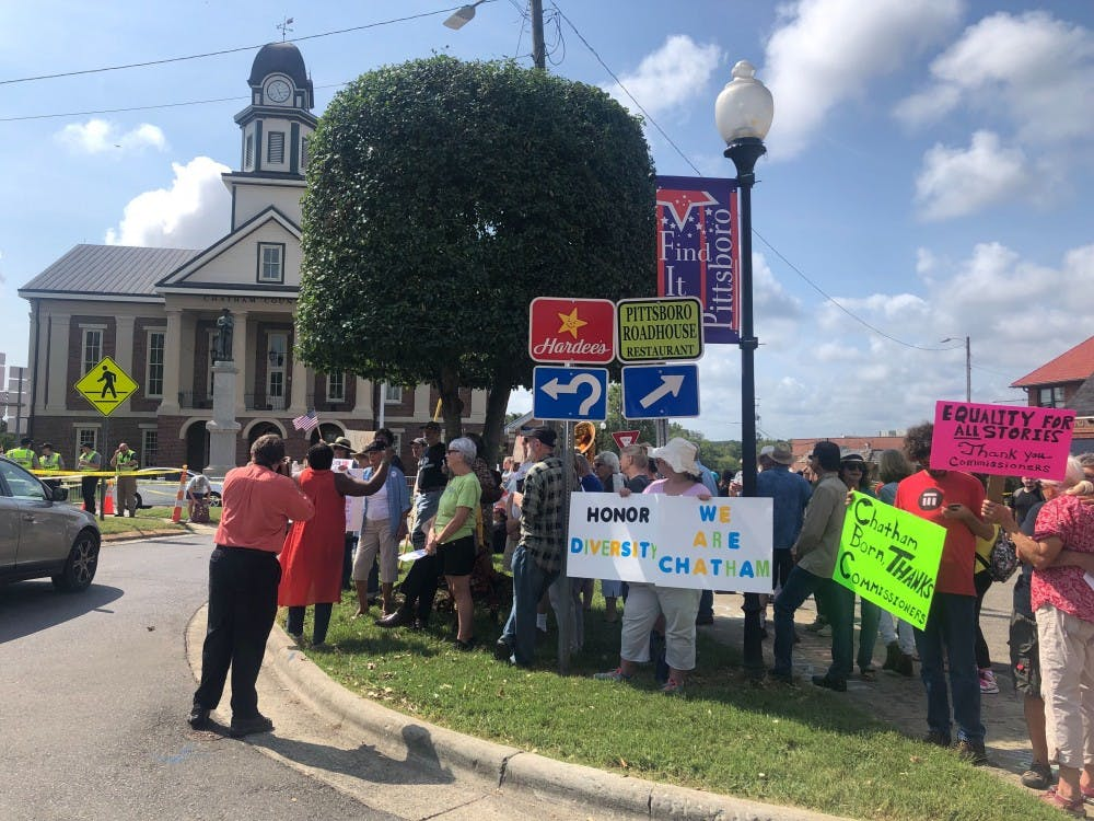 Protesters encounter protesters in Pittsboro on Saturday, Sept. 14, after commissioners made a decision to remove a confederate statue.