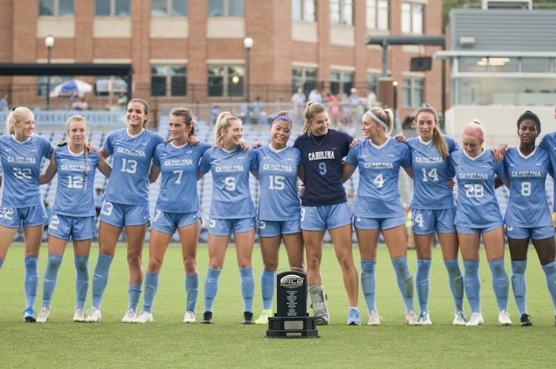 "The Tar Heels gather together to sing ""Hark the Sound"" to celebrate both their ACC regular-season title victory against Virginia Tech and Senior Day on Sunday, Oct. 27, 2019."