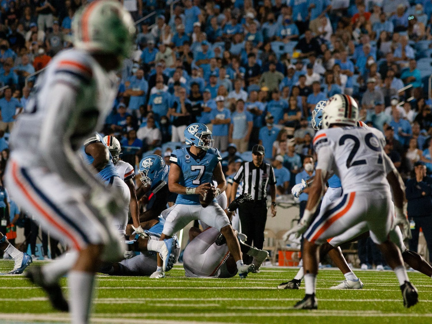 UNC junior quarterback Sam Howell (7) prepares for a long pass down the field in the second quarter against the University of Virginia. UNC defeated the Cavaliers 59-39, their second win of the season.