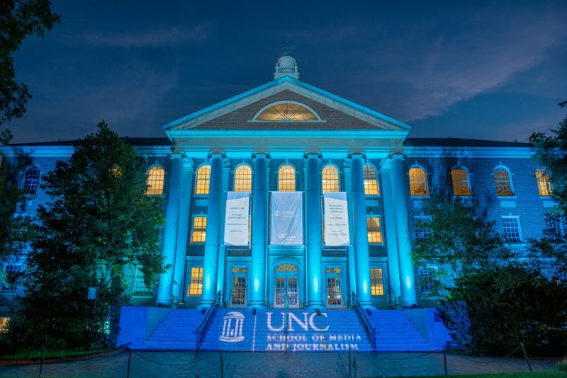 CHAPEL HILL,  NORTH CAROLINA - AUGUST 27, 2015: The University of North Carolina Chapel School of Media and Journalism  is bathed in blue light to kickoff a campaign celebrating the schools new name.  The school strives to train the next generation of media professionals, including journalists, strategic communicators, teachers and researchers while being a resource to journalism and communication professionals. (Photo by Steve Exum/exumphoto.com)