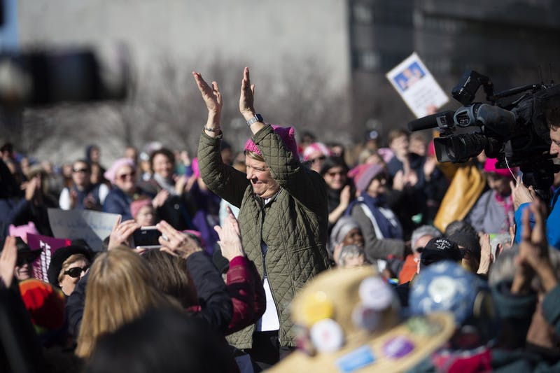 Chapel Hill Mayor Pam Hemmminger stands to be recognized at the Raleigh Women's March at Halifax Mall on Sunday, Jan. 26, 2020.