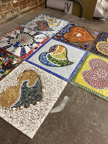 Carlos González García, a mosaicist new to the Hillsborough area, combined over 150 mosaics made by community members this summer as part of the #LoveHillsborough Community Art Project. Photo courtesy of Carlos González García.
