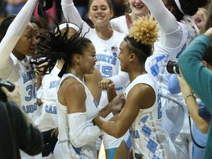 UNC players celebrate after a historic win against Notre Dame in Carmichael Arena on Sunday, Jan. 27, 2019. UNC won 78-73.