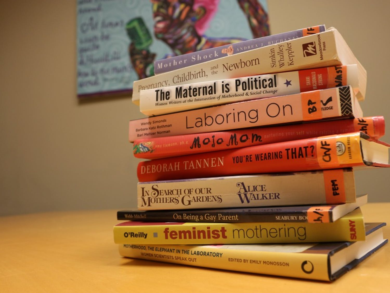 A stack of parenting books that is available to students in the Carolina Women's Center, located in the Stone Center building. The Carolina Women's Center provides information about parenting resources in the UNC community.