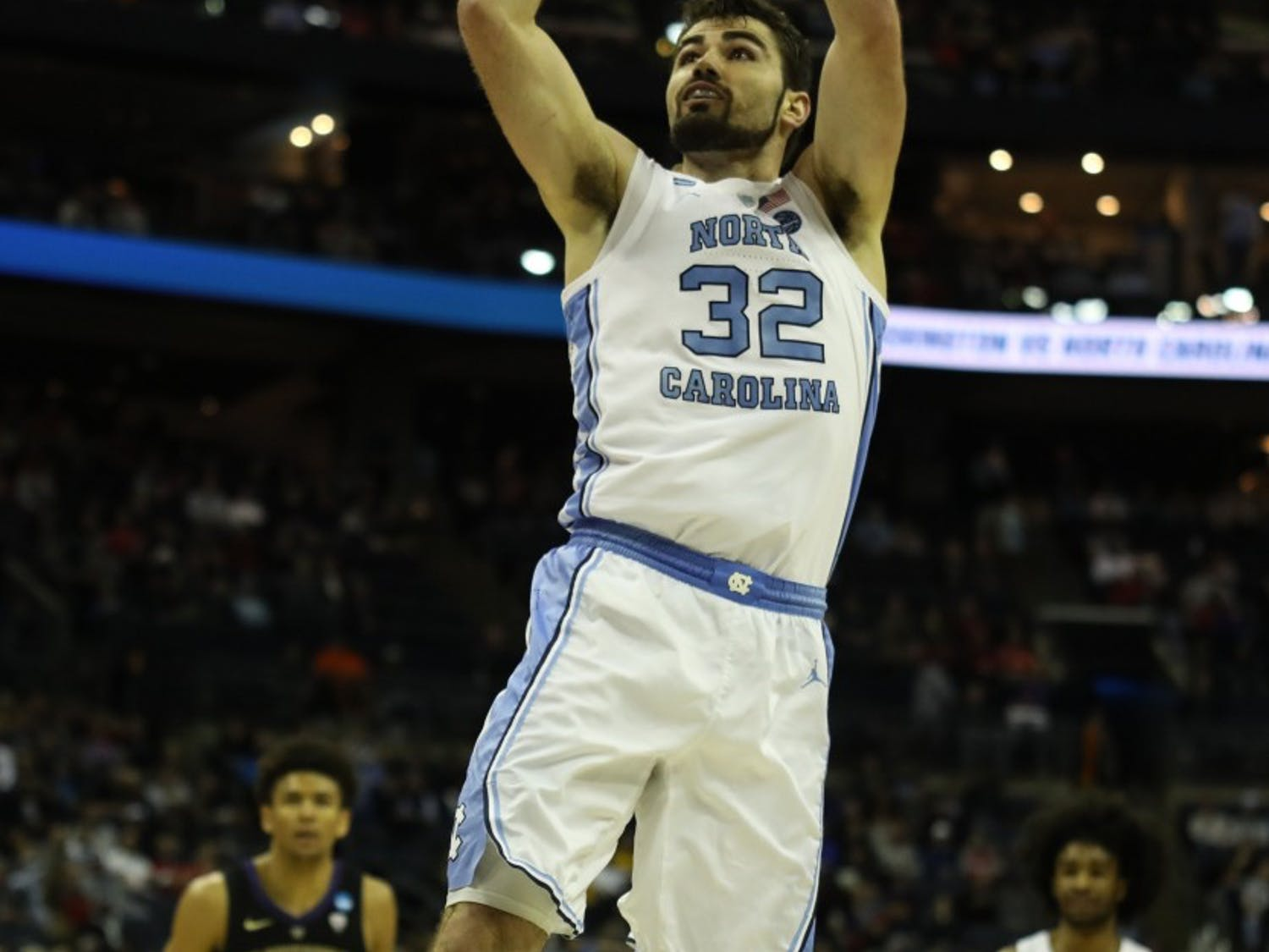 Senior forward Luke Maye (32) takes a shot against Washington in the second round of the NCAA tournament at Nationwide Arena in Columbus, OH on Sunday, March 24, 2019. UNC defeated Washington 81-59.