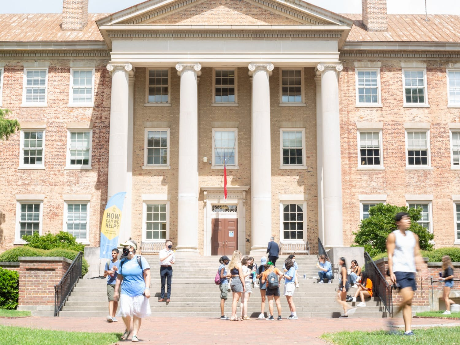 Students walk past South Building on Monday, Aug. 16, 2021.