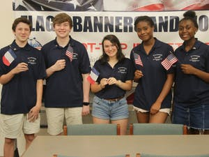 High school students Daniel Price, Matthew Griesedieck, Elena Lowinger, Kaelyn Elien, Cathy Charles and Miles Charles (not pictured) are coming together this summer to take two World War II veterans to see the war memorial at Normandy, France.