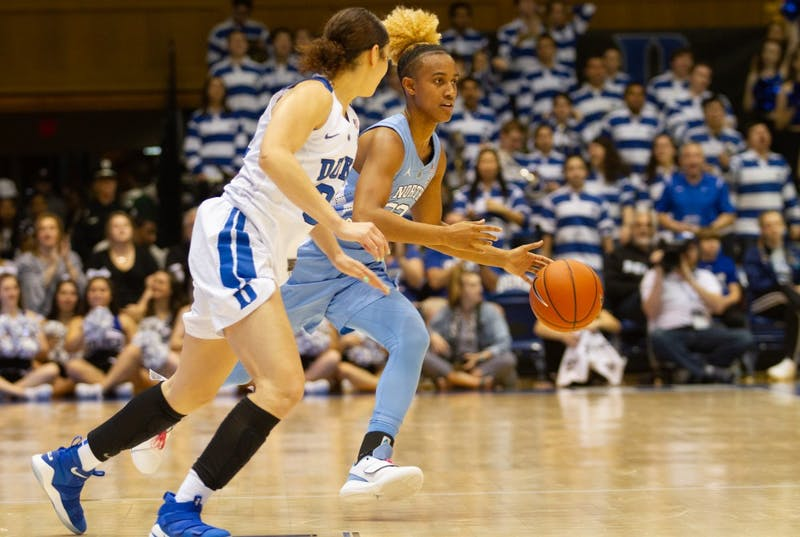 UNC redshirt senior guard Paris Kea (22) makes a drive past Duke sophomore guard Jayda Adams (32) at Cameron Indoor Stadium on Sunday, Mar. 3, 2019. The Tar Heels lost 44-62.