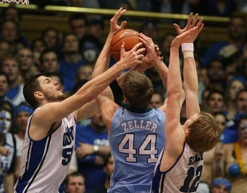 Duke's Brian Zoubek (55) and Kyle Singler (12) double-team North Carolina's Tyler Zeller (44) during NCAA men's basketball action at Cameron Indoor Stadium, in Durham, North Carolina, on Saturday, March 6, 2010. Duke topped North Carolina, 82-50. (Chuck Liddy/Raleigh News & Observer/MCT0