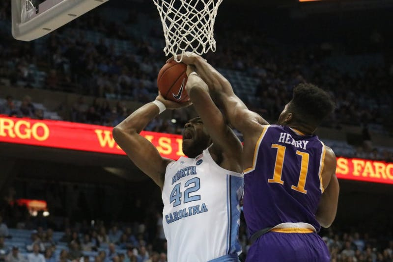 UNC forward Brandon Huffman (42) makes a powerful jump in a scoring drive against Tennessee Tech on November 18th in the Dean Dome.