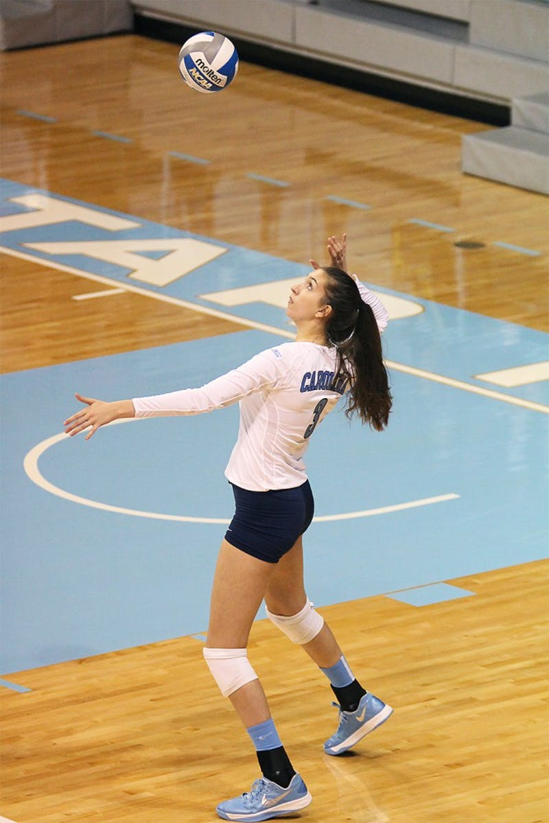 Freshman middle blocker Beth Nordhorn serves the ball during the Tar Heel's victory over NC State.  Nordhorn finished the match with two blocks and one kill.