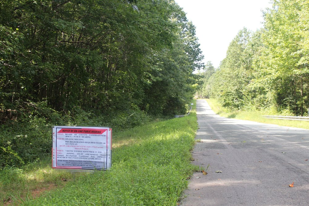 <p>A sign at Research Triangle Logistics Park gives notice of a virtual public hearing about the zoning of the park in September. A month later, development at the park was approved by the Orange County Board of Commissioners.</p>