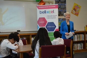Durham County Commissioner and EDCI co-founder Ellen Reckhow presents BellXcel results in front of Y.E. Smith Elementary students.