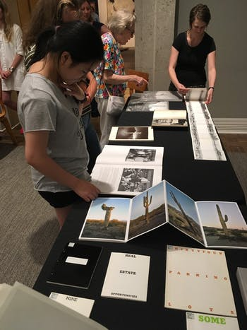 Visitors at the Way Out West: Celebrating the Gift of Hugh A. McAllister Jr. Collection Pop-Up at Ackland Art Museum, a similar event to the upcoming photo book pop-up. Photo courtesy of Lindsey Hale.