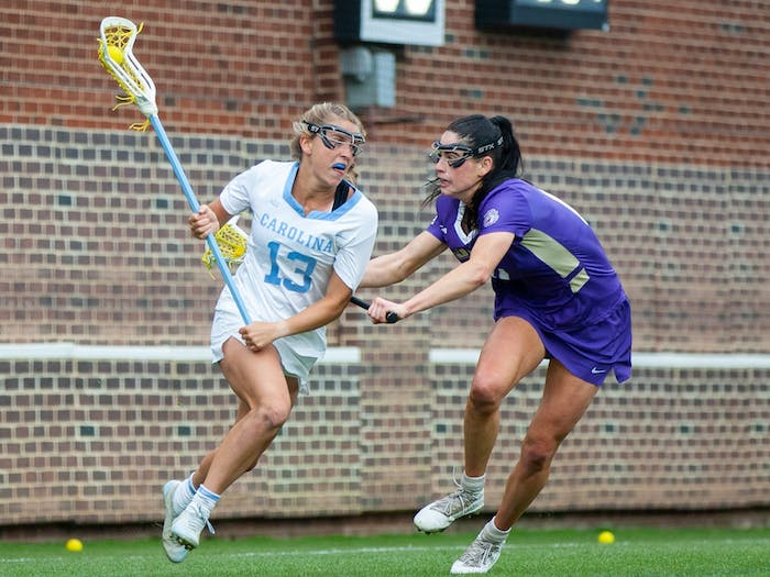 UNC first-year attacker Caitlyn Wurzburger (13) runs with the ball at the second round of the NCAA tournament against James Madison on Sunday May 16, 2021 at the Dorrance Field in Chapel Hill. The Tar Heels won 14-9.