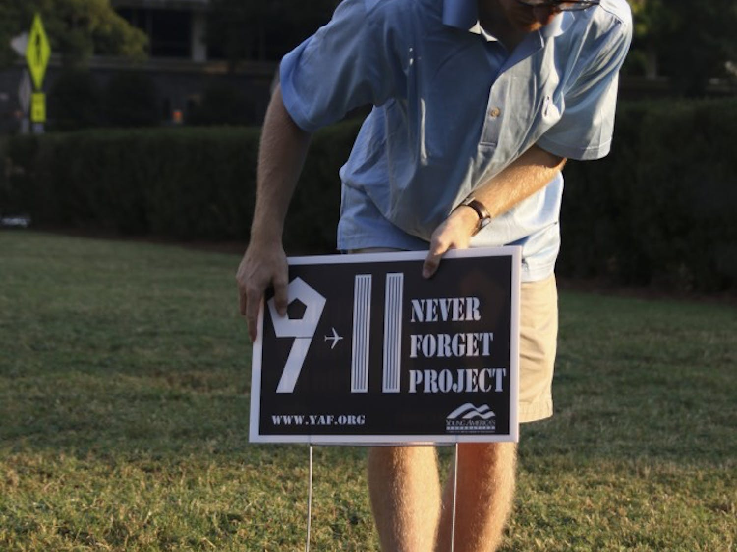 The UNC College Republicans placed America flags in the grass in front of the bell tower on Sunday morning to honor the victims of the terrorist attacks on 9/11.