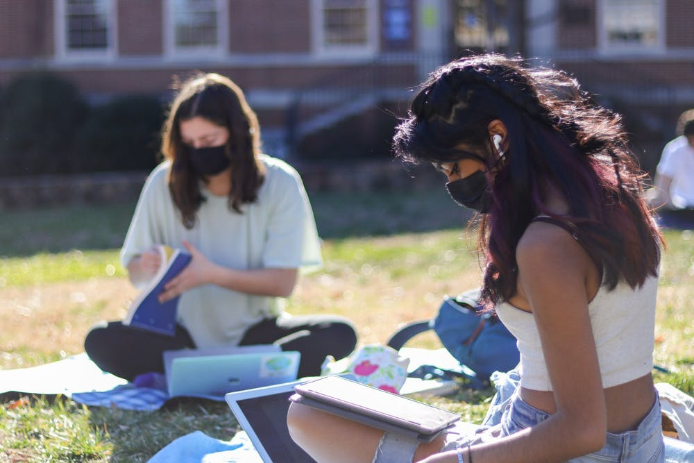 Sophomore students Naomi Nice and Megha Iyer study on Polk Place on Feb. 25, 2021.