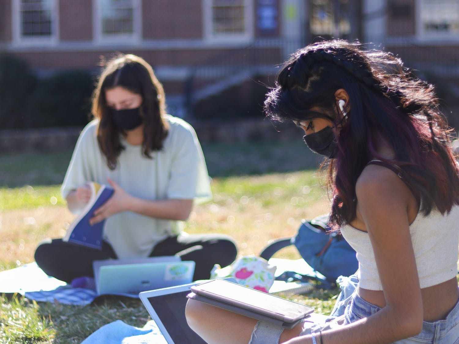 Sophomore students Naomi Nice and Megha Iyer study on Polk Place on Feb. 25, 2021.