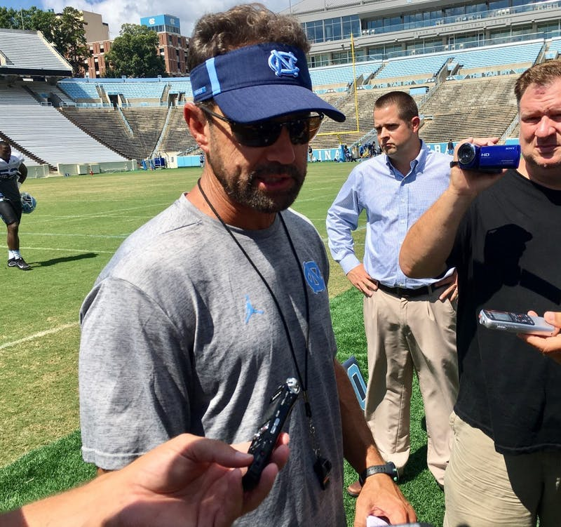 North Carolina football head coach Larry Fedora addresses the media after his team's practice on Friday morning in Kenan Stadium.