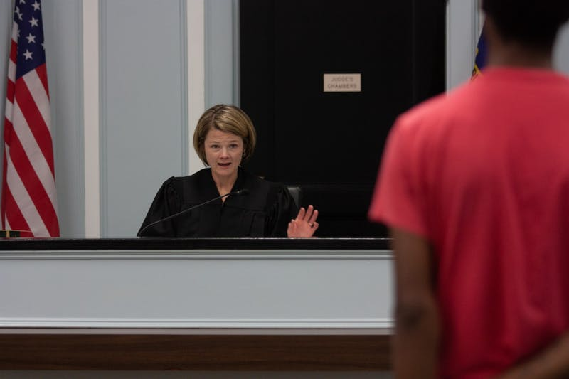District Judge Samantha Cabe talks to a participant in the North Carolina Recovery Courts at the Chapel Hill Courthouse on Wednesday, Feb. 26, 2020. The Recovery Courts were implemented to help previous offenders with their drug and alcohol-related treatment plans.