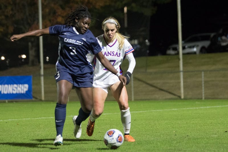 Redshirt Junior forward Ru Mucherera (3) battles against an opposing player during Women's Soccer's 4-1 victory against Kansas in the second round of the NCAA Women's Soccer Tournament on Friday, Nov. 16 at Wake Med Soccer Park in Cary, North Carolina.