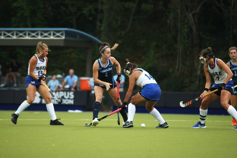 Erin Matson (1), surrounded by Duke players, reaches for ball in a game that UNC won 2-0, marking their 33rd consecutive victory.