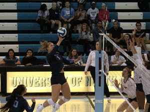 UNC player Katherine Esterley attempts to lob the ball over defending UVA players on Sunday October 14th in Carmichael Area.