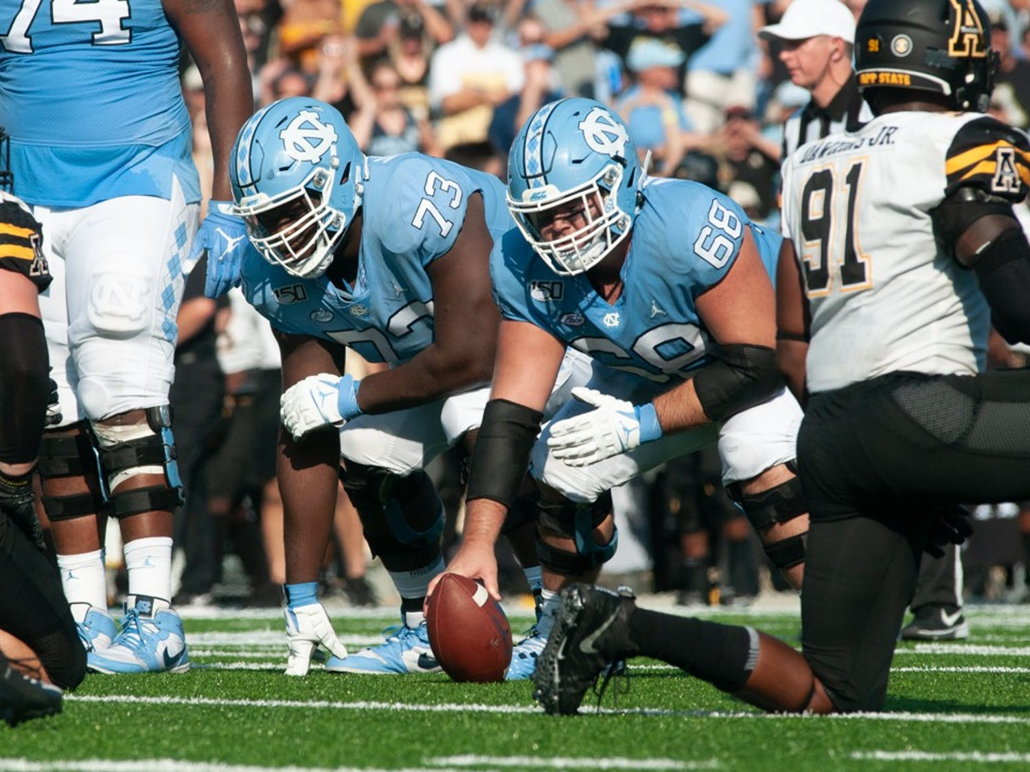 UNC offensive linemen (68) Brian Anderson and (73) Marcus McKethan prepare to snap the ball in the game against Appalachian State on Saturday Sept. 21, 2019.